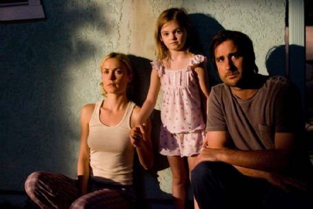 Morgan Lily Radha Mitchell as Dawn,  as Millie Stupek and Luke Wilson as Henry Poole in Henry Poole Is Here.