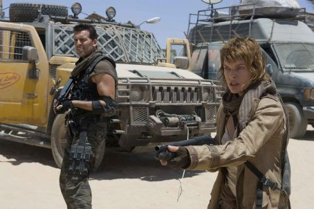 Carlos Olivera Oded Fehr (left) and Milla Jovovich star in Screen Gems' action/horror film RESIDENT EVIL: EXTINCTION. Photo by: Rolf Konow