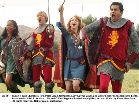 Adam Campbell Susan (Faune Chambers, left), Peter (), Lucy (Jayma Mays), and Edward (Kal Penn) charge into battle. Photo credit: John P. Johnson
