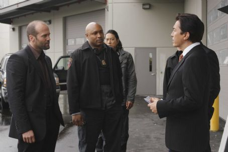 John Lone Crawford (Jason Statham, left), Wick (Mathew St. Patrick, center), and Chang (, right) in a scene from WAR. Photo credit: Douglas Curran