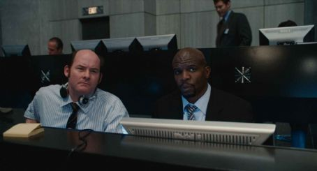 "David Koechner DAVID KOECHNER as Agent Larabee and TERRY CREWS as Agent 91 in Warner Bros. Pictures' and Village Roadshow Pictures' action comedy ""Get Smart,"" distributed by Warner Bros. Pictures. The film stars Steve Carell, Anne Hathaway, Dwayn"