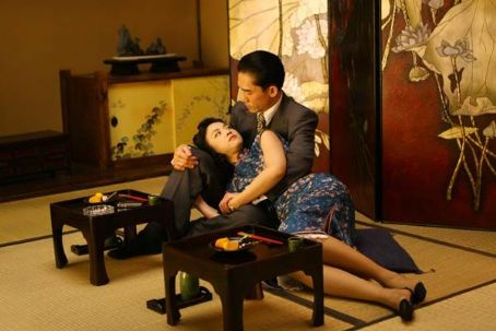 Tony Leung Chiu Wai - Tony Leung (top) and Tang Wei (bottom) star in Ang LeeÆs LUST, CAUTION, a Focus Features release.