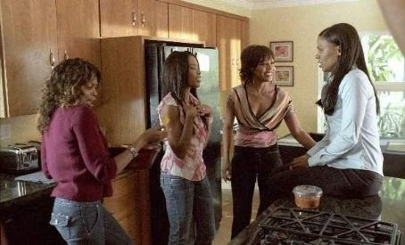 Wendy Raquel Robinson Taraji P. Henson (left), Golden Brooks (center left),  (center right) and Sanaa Lathan (right) star in Sanaa Hamri's Something New, a Focus Features release. Photo by Sidney Baldwin.