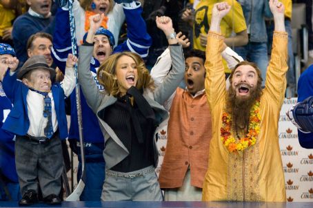 Rajneesh (Left to right) Verne Troyer as Coach Cherkov, Jessica Alba as Jane Bullard, Manu Narayan as  and Mike Myers as Guru Pitka star in the comedy 'The Love Guru.' Photo Credit: George Kraychyk. Copyright (c) 2008 by PARAMOUNT PICTURES. All Rig