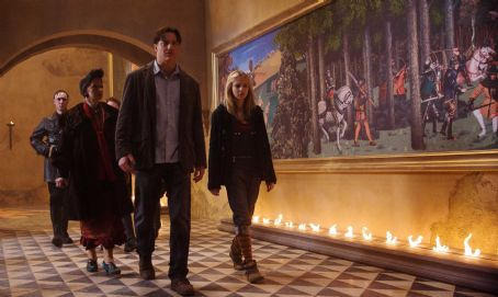 Meggie Folchart (L-R) The Black Jackets force Elinor (HELEN MIRREN), Mo (BRENDAN FRASER) and Meggie (ELIZA HOPE BENNETT) through the castle hallways in New Line Cinema's fantasy adventure 'Inkheart,' also starring PAUL BETTANY, JIM BROADBENT and ANDY SERKIS.