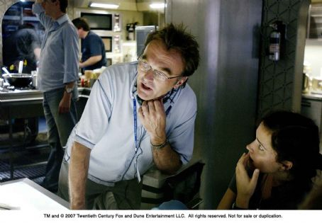 Danny Boyle From left: Director  and Rose Byrne on the set of SUNSHINE. Photo Credit: Alex Bailey