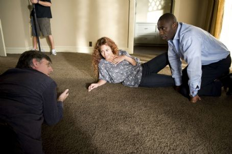 (l to r) Director Steve Shill, Beyoncé Knowles and Idris Elba on the set of Screen Gems' thriller OBSESSED. Photo By:  Suzanne Tenner. © 2009 Screen Gems, Inc. All rights reserved.
