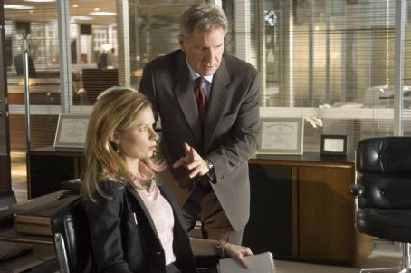 """Mary Lynn Rajskub  as Janet Stone and Harrison Ford as Jack Stanfield in Warner Bros. Pictures' and Village Roadshow Pictures' action thriller """"Firewall."""" The film also stars Paul Bettany. Photo by Diyah Pera"""