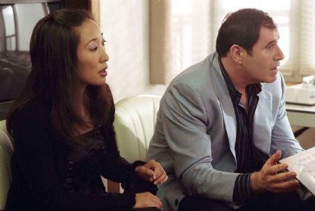 Sandra Oh and Richard Kind as marketing executives in director Christopher Guest's For Your Consideration. Photo credit: Suzanne Tenner © 2006 Shangri-La Entertainment, LLC.