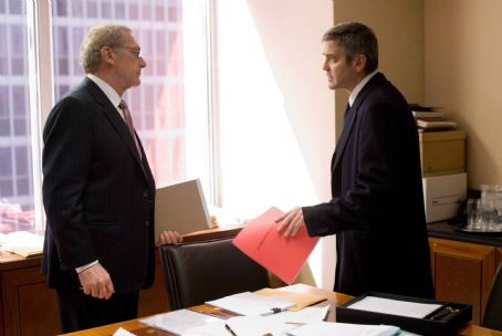 "Sydney Pollack SYDNEY POLLACK as Marty Bach and GEORGE CLOONEY as Michael Clayton in Warner Bros. Pictures, Samuels Media and Castle Rock Entertainment's drama ""Michael Clayton,"" distributed by Warner Bros. Pictures. Photo by Myles Aronowitz"