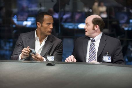"David Koechner DWAYNE JOHNSON as Agent 23 and DAVID KOECHNER as Agent Larabee in Warner Bros. Pictures' and Village Roadshow Pictures' action comedy ""Get Smart,"" distributed by Warner Bros. Pictures. The film also stars Steve Carell, Anne Hathawa"
