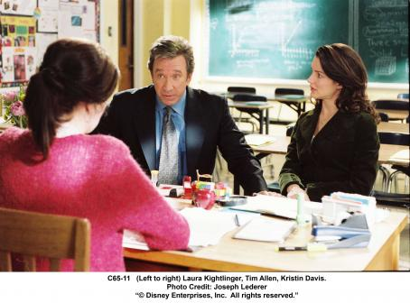 Laura Kightlinger (Left to right) , Tim Allen and Kristin Davis in The Shaggy Dog. Photo Credit: Joseph Lederer '© 2006 Disney Enterprises, Inc. All rights reserved.'