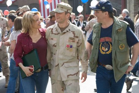 "Linda Emond (Left to right) Ida (Linda Edmond), Brandon (Ryan Phillippe) and Roy King (Ciarán Hinds) celebrate upon the young man's return home from his tour of duty in ""Stop-Loss."" Photo Credit: François Duhamel. © 2007 by Paramount Pictures. All R"