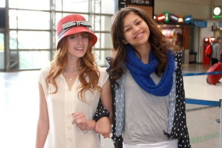 Bella Thorne and Zendaya Coleman posed for photos before catching an outbound flight today, March 26, at Los Angeles International Airport. The Disney darlings were joined by their families