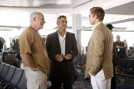"""Jerry Weintraub Producer JERRY WEINTRAUB, GEORGE CLOONEY, who stars as Danny Ocean, and BRAD PITT, who stars as Rusty Ryan, on the set of Warner Bros. Pictures' and Village Roadshow Pictures' """"Ocean's Thirteen,"""" distributed by Warner Bros. P"""