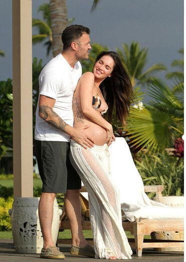 Pregnant Megan Fox Poses in a Bikini and Shows PDA