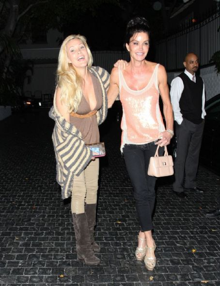 Former beauty queen Shanna Moakler and former supermodel Janice Dickinson share a kiss outside the infamous Chateau Marmont in West Hollywood